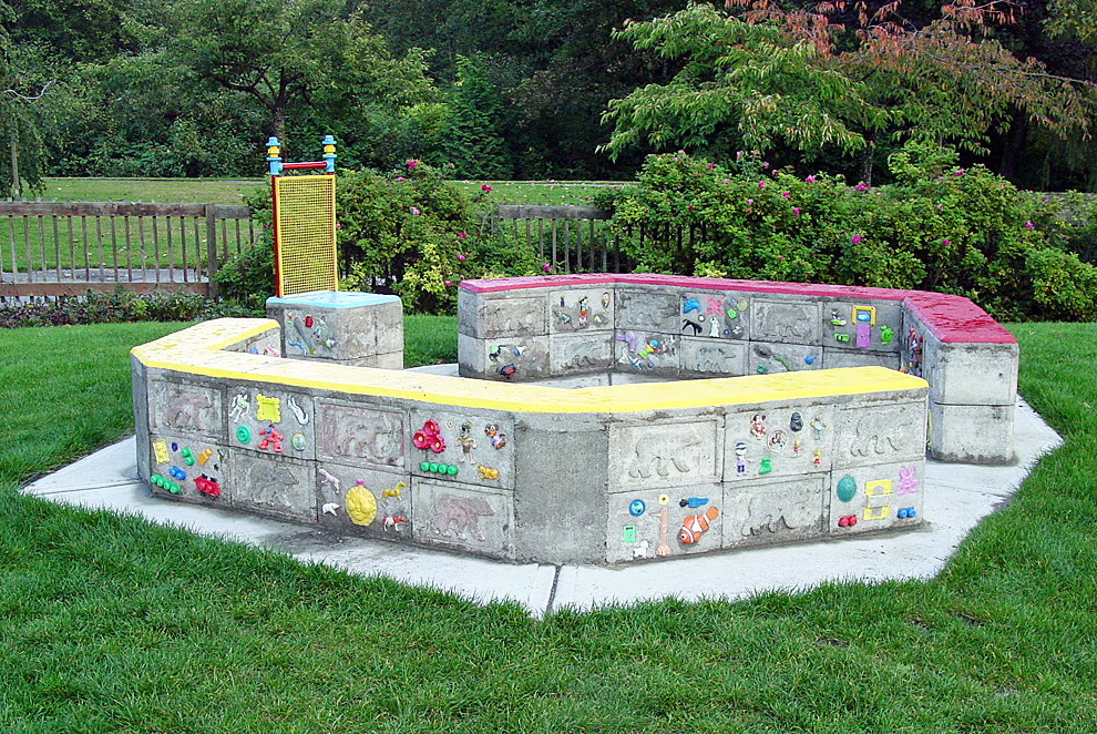 Memory Banks, September 2007 3' h x 12' w x 11.5' d cast and hand-formed concrete, found objects  and paint Installed in Bear Creek Park, Surrey, BC