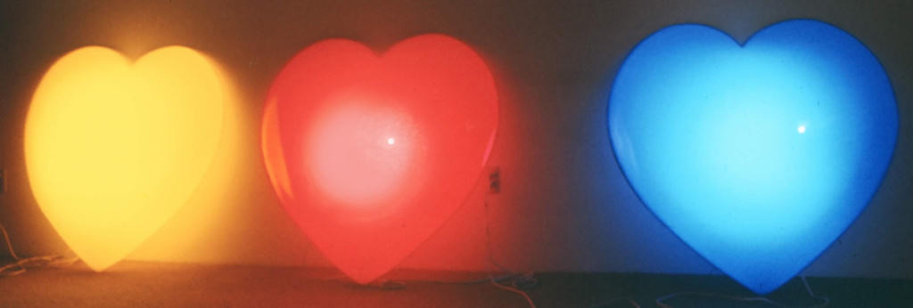 Light Hearts, Marion-Lea JAmieson, 1974; formed sheet acrylic, flourescent fixtures & hardware; each 4' x 4' x 1'.