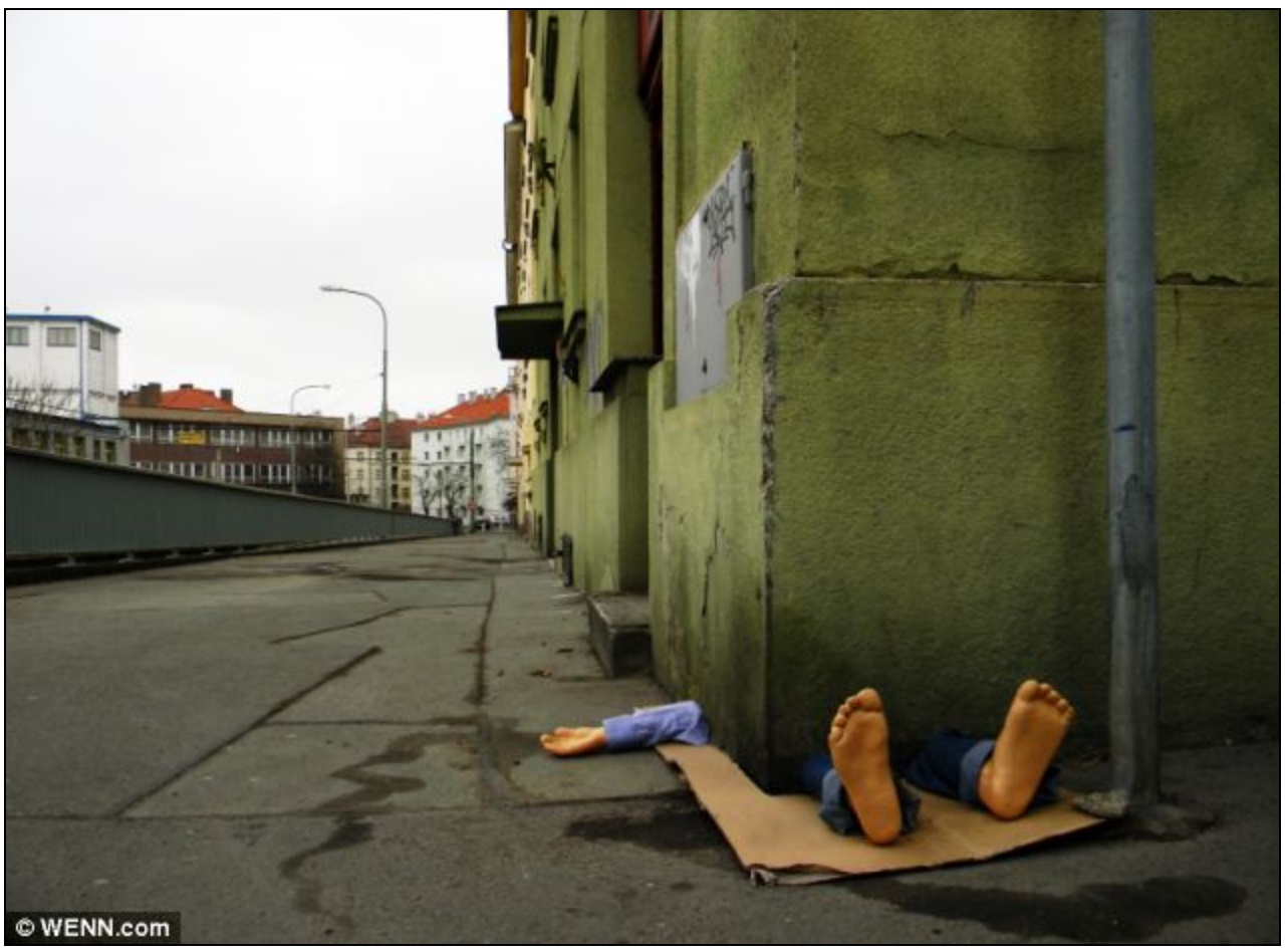 Man crushed by building; Fra Biancoshock; street installation, Prague, Czech Republic